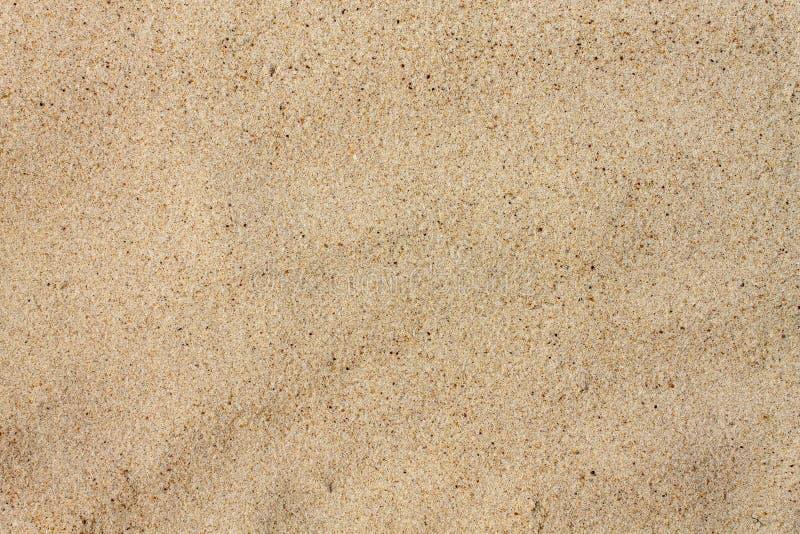 Aproximação de quartzo de textura. Areia na praia foto de stock
