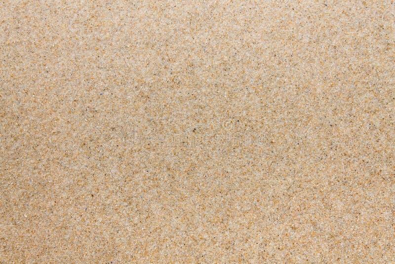 Aproximação de quartzo de textura. Areia na praia imagem de stock