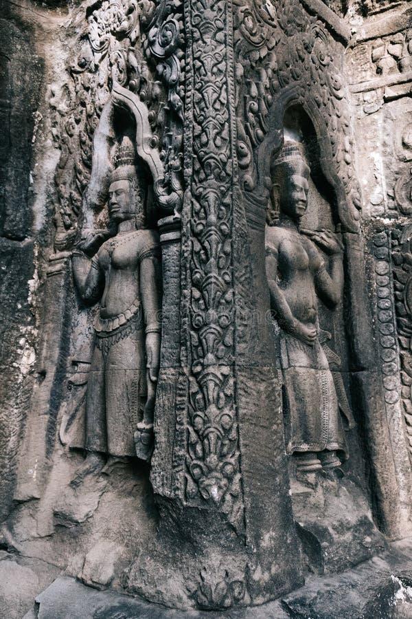 Apsara舞蹈家石雕刻在吴哥寺庙,暹粒,柬埔寨 免版税库存图片