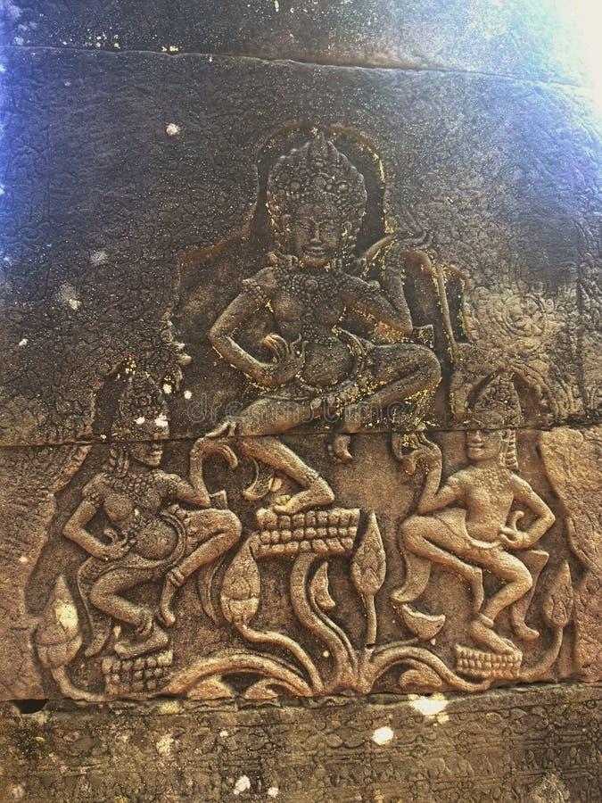 Apsara dansare sned på väggen av den forntida templet för den Prasat Bayon en khmer Angkor Wat i Siem Reap, Cambodia royaltyfria foton