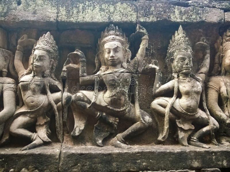 Apsara dansare sned på väggen av den forntida templet för den Prasat Bayon en khmer Angkor Wat i Siem Reap, Cambodia arkivbild