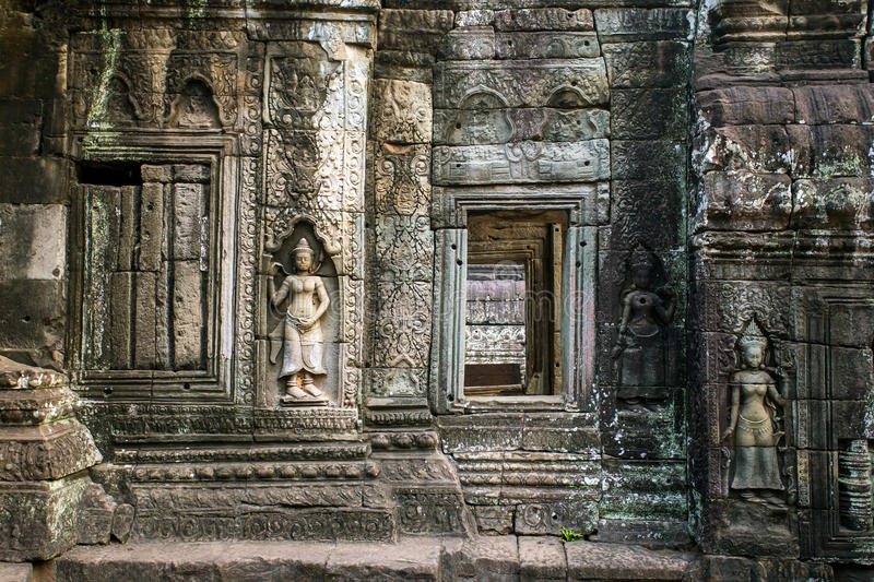 Apsara stone carvings on the wall of angkor ta prohm