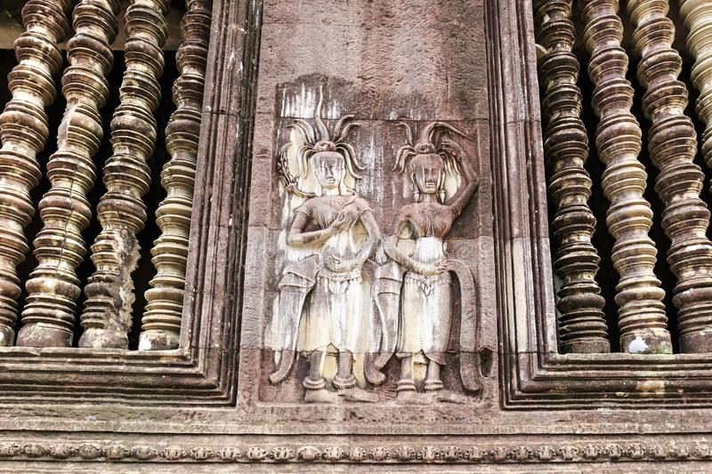 Apsaras on a Wall Near the Center of Cambodia`s Angkor Wat Templ stock photo