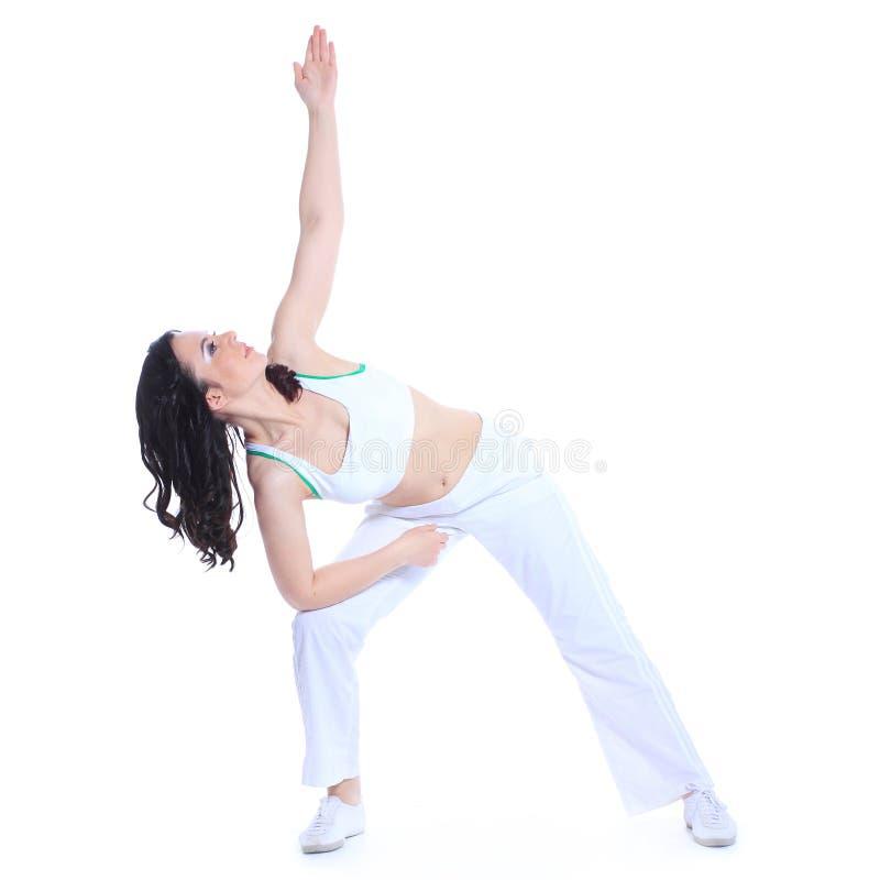 Aptitud, deporte, entrenamiento, gimnasio y concepto de la forma de vida - mujer deportiva hermosa que hace ejercicio en el piso fotos de archivo