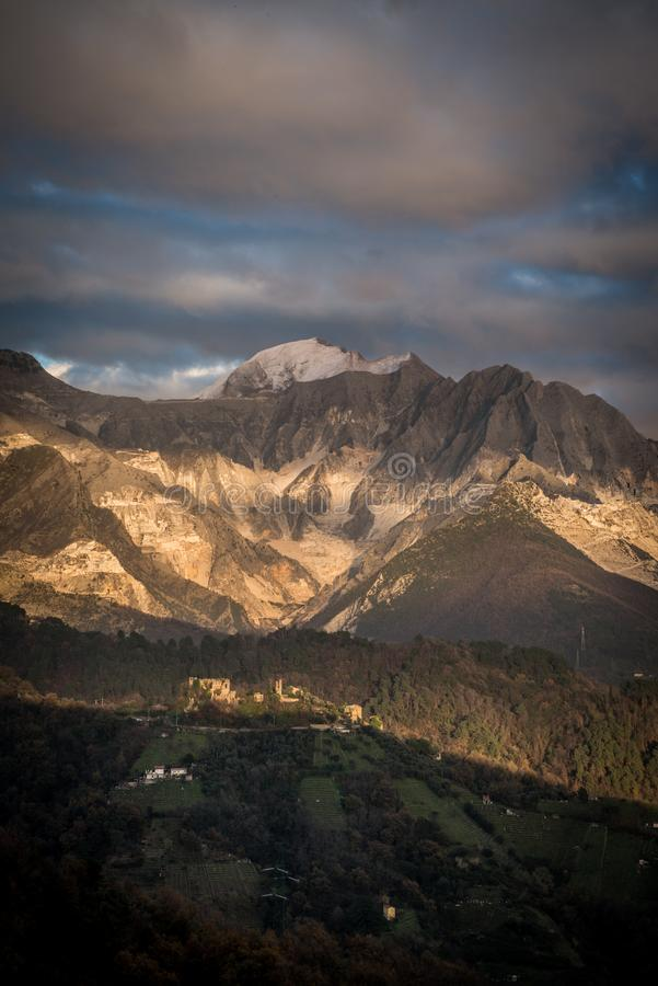 Apuan Alps and Carrara marble quarries. Landscape of the Apuan Alps and Carrara marble quarries with Moneta Castle, Carrara, Tuscany, Italy royalty free stock images