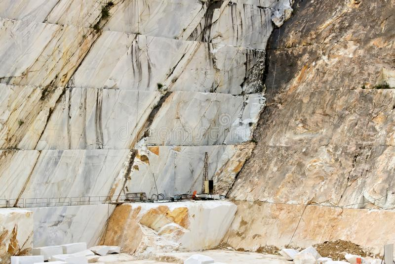 A quarry of white marble. The precious white Carrara marble has been extracted from the Alpi Apuane quarries since Roman times royalty free stock photo