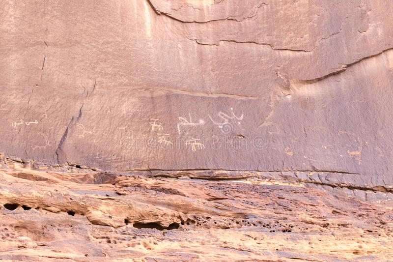 Fragment of surviving rock inscriptions left over from ancient times on a rock in the Wadi Rum desert near Aqaba city in Jordan stock images