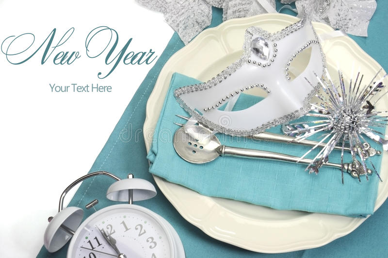 Aqua blue theme elegant Happy New Year dining table place settings royalty free stock images