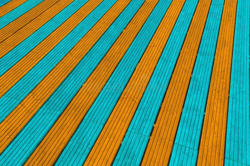 Aqua en oranje decking raad stock foto