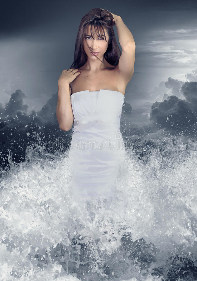 Aqua girl . Young woman coming out of the water royalty free stock photo