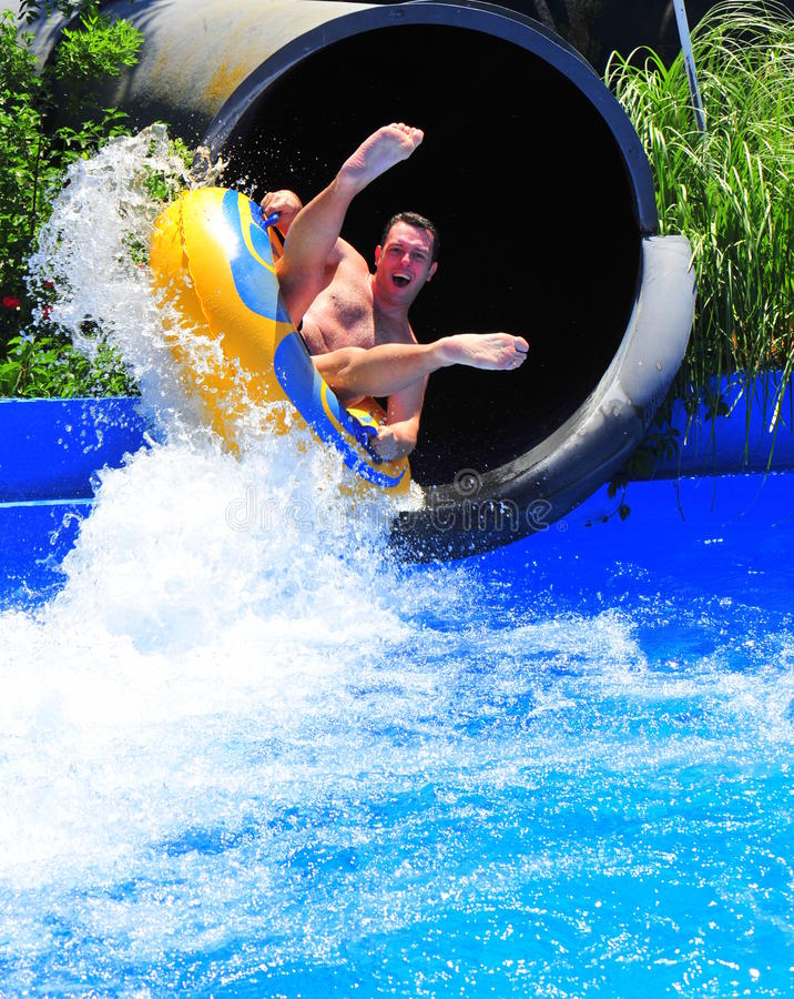 Free Aqua Park Fun - Man Enjoying A Water Tube Ride Stock Photography - 25156642