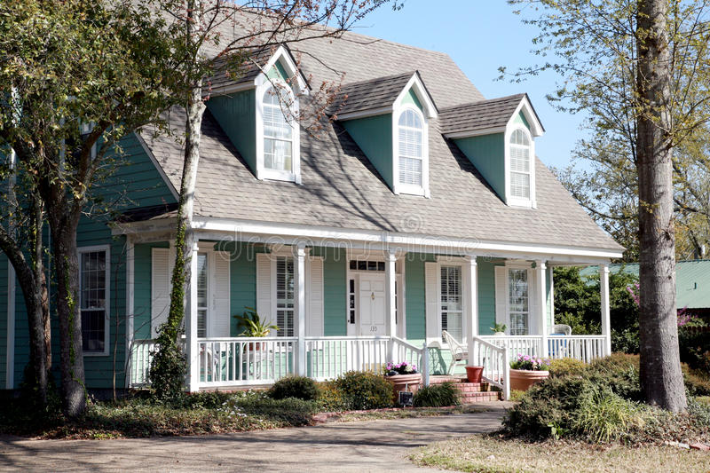 Aqua Victorian Style Home. Aqua one-story American Victorian style home with a white trim stock images