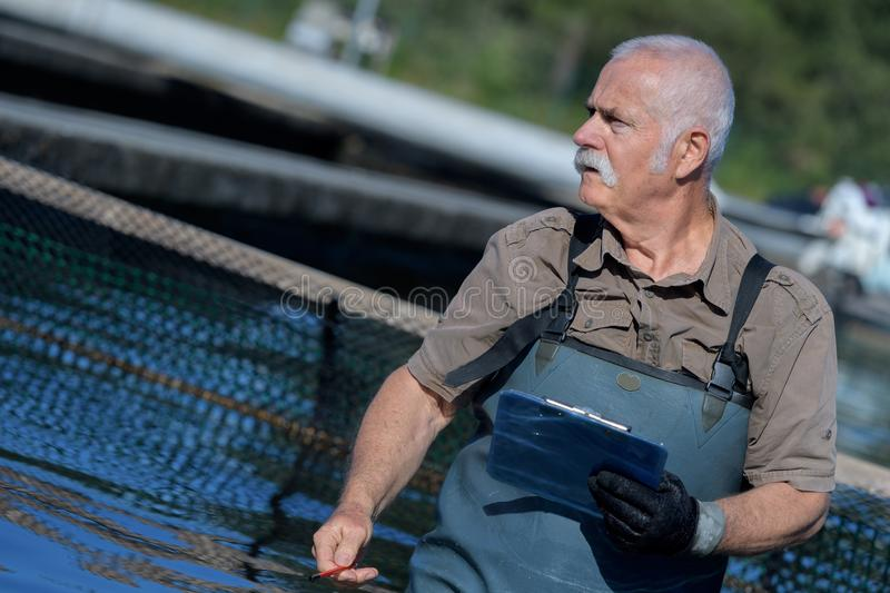 Aquaculture farmer holding folder royalty free stock photos