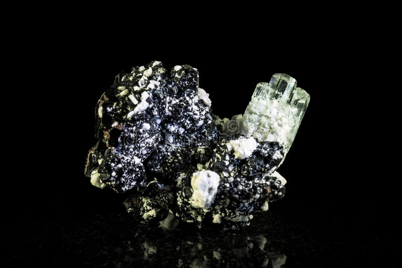 Aquamarine crystal and schorl, black background stock photography