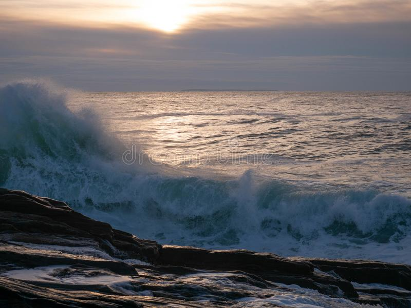 Aquamarine Sunrise Wave Crashes onto Pemaquid Point royalty free stock image