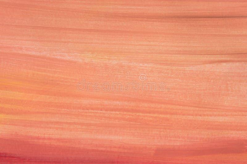 Aquarela alaranjada pintada na textura de papel do fundo imagem de stock