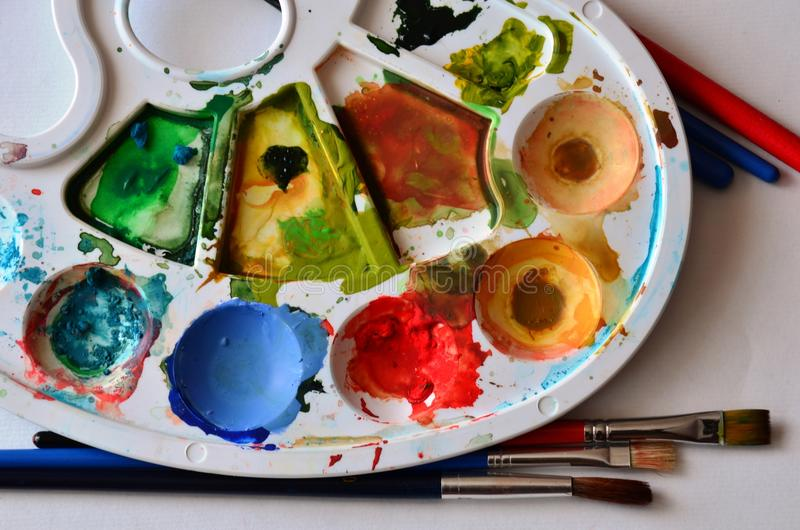 Aquarell Colors in Palette. Palerte with set of colors and brushes royalty free stock photography