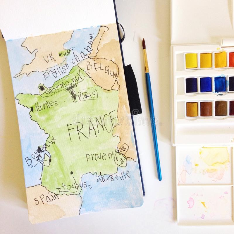 Aquarellkarte von Frankreich durch Kind lizenzfreies stockbild