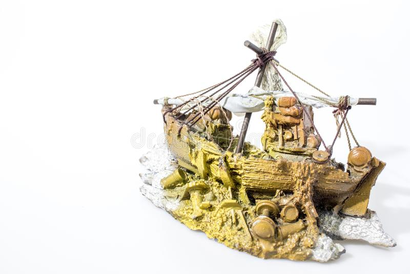 Aquarium accessories boat in a white backgorund stock photo