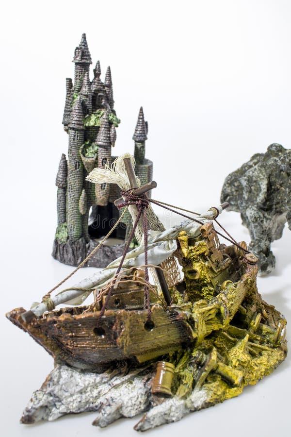 Aquarium accessories composition boat, castle and rock stock images
