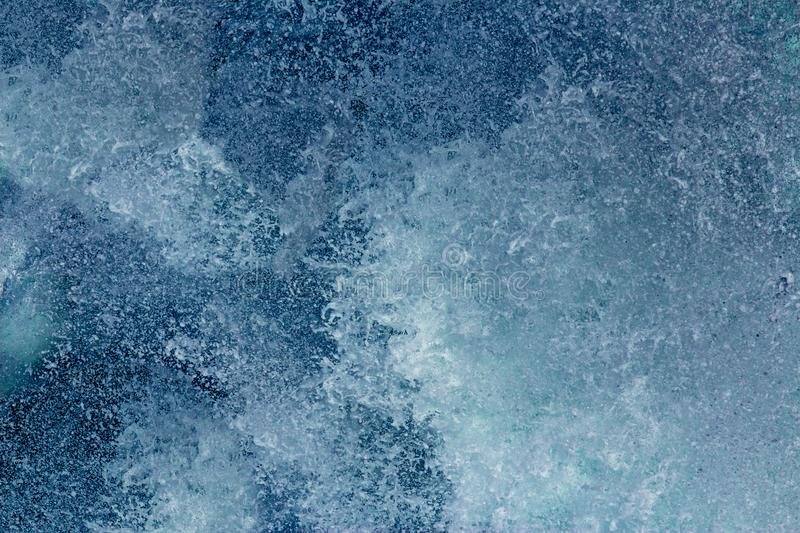 Aquatic background of sea surf waves close up with clear water and white foam stock image