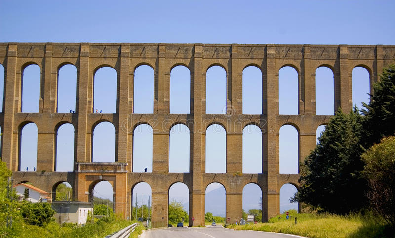 Aqueduct. Ancient Aqueduct in south of Italy royalty free stock photography