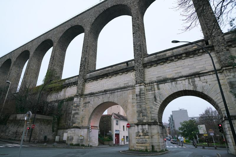 Aqueduct in Arcueil-Cachan, Paris, in the morning. Paris, France-January 21, 2018: The aqueduct between the towns Arcueil and Cachan on the South of Paris, built stock photo