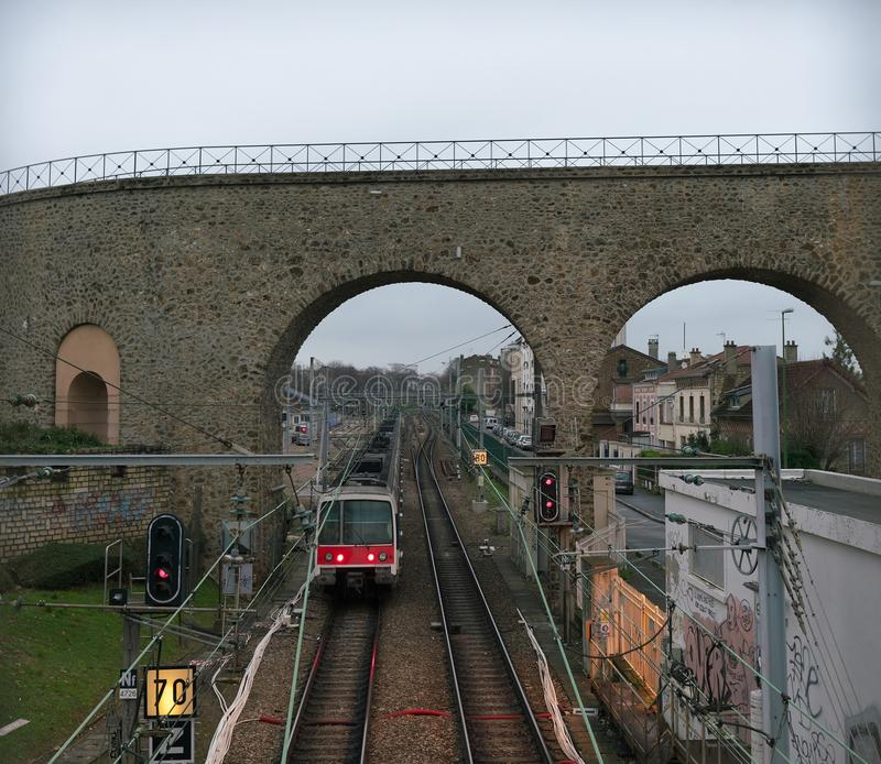 Aqueduct in Arcueil-Cachan, Paris, in the morning. Paris, France-January 21, 2018: The aqueduct between the towns Arcueil and Cachan on the South of Paris, built stock images