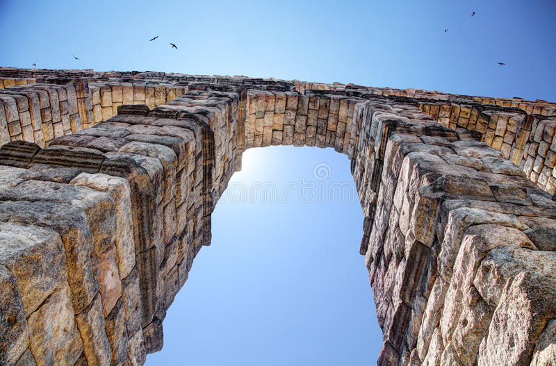 Aqueduct, Segovia, Spain. The Aqueduct of Segovia (or more precisely, the aqueduct bridge) is a Roman aqueduct and one of the most significant and best-preserved stock photography
