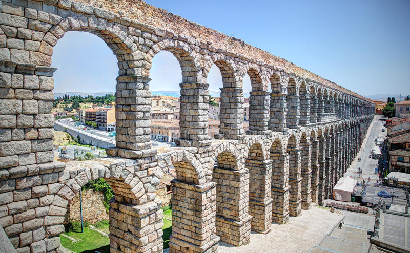 Aqueduct, Segovia, Spain. The Aqueduct of Segovia (or more precisely, the aqueduct bridge) is a Roman aqueduct and one of the most significant and best-preserved royalty free stock photo
