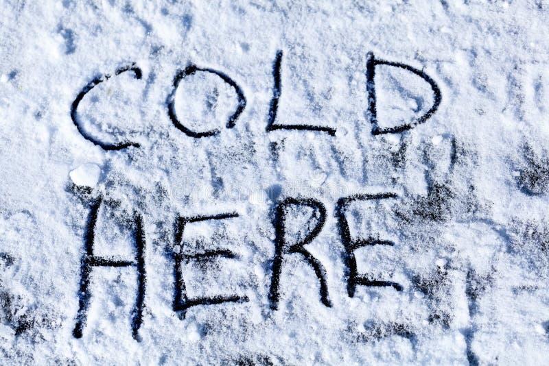 Aqui inscrição fria no gelo foto de stock royalty free