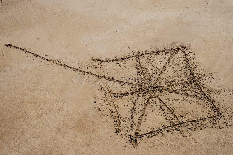 Aquilone che assorbe il fondo della sabbia in un giorno luminoso immagine stock libera da diritti