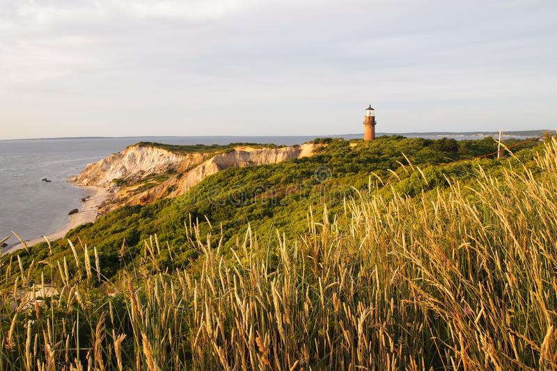 Aquinnah Lighthouse and cliffs at sunset royalty free stock photo