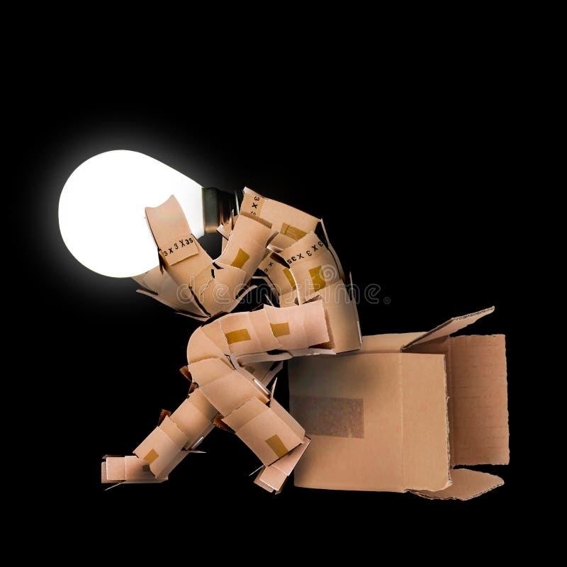 Żarówki pudełka mężczyzna charakter fotografia stock