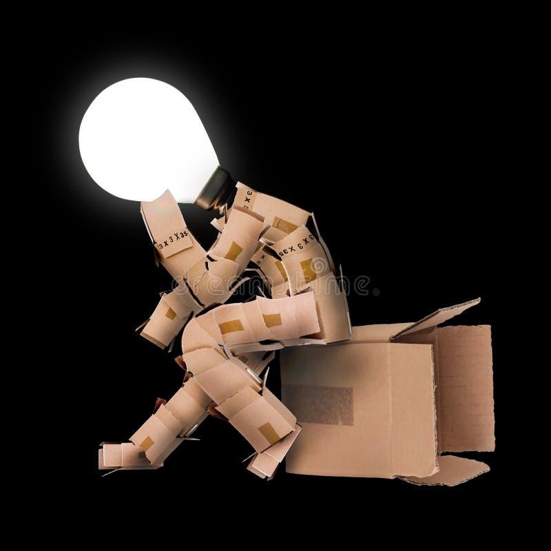 Żarówki pudełka mężczyzna charakter zdjęcia royalty free