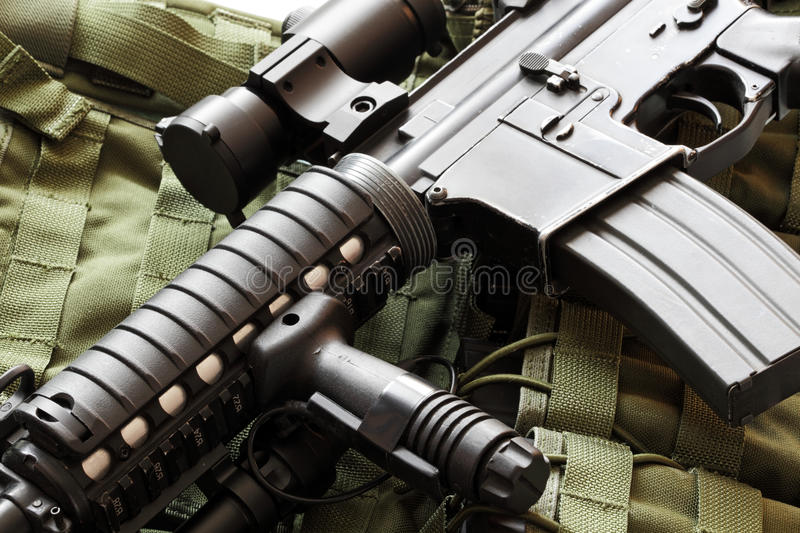 AR-15 carbine and tactical vest. Military still life. AR-15 carbine (The Black Rifle) and tactical vest royalty free stock photo