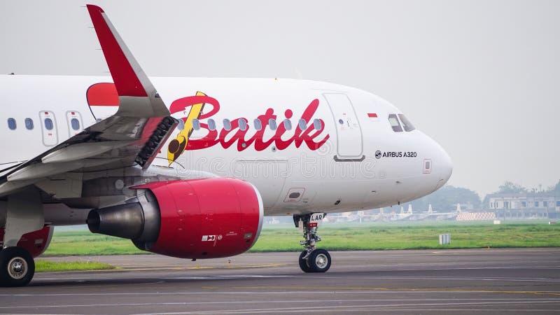 Ar Airbus A320 PK-LAR do Batik imagens de stock