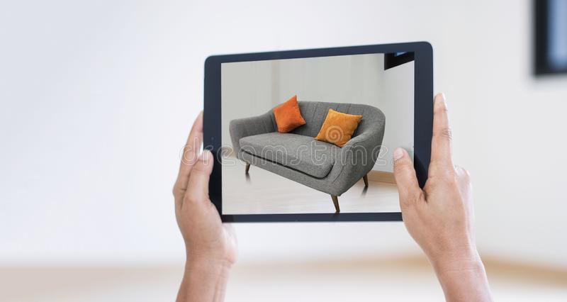AR augmented reality. Hand holding digital tablet, AR application royalty free stock images