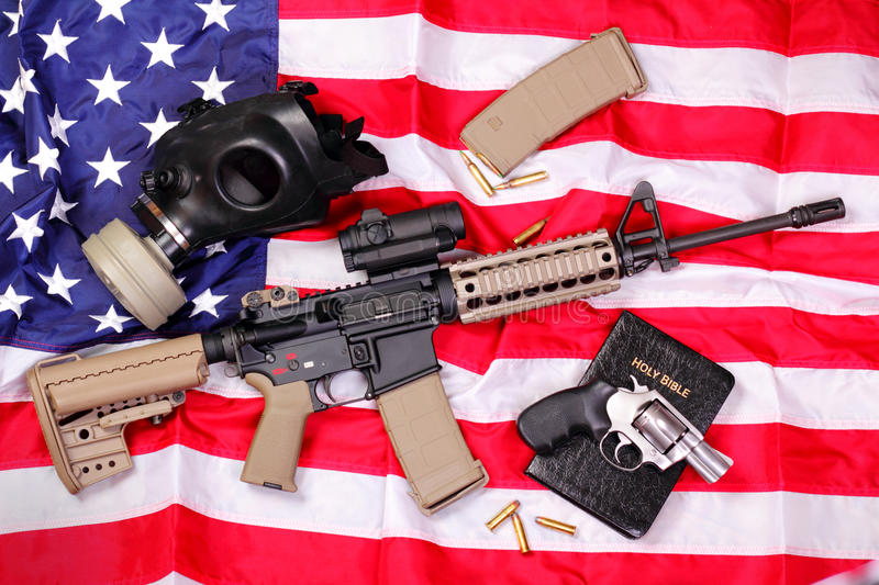 AR Rifle, a Bible, a Gas Mask & a Pistol on Americ stock image