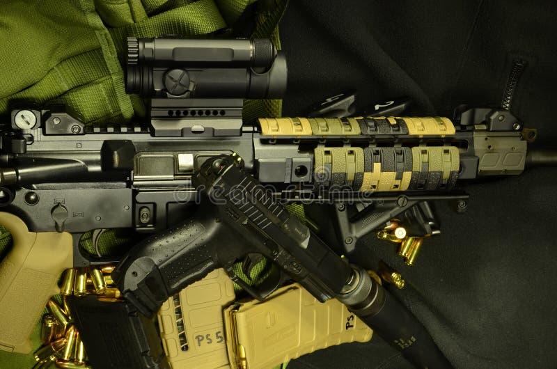 AR 15 with silenced pistol stock photos