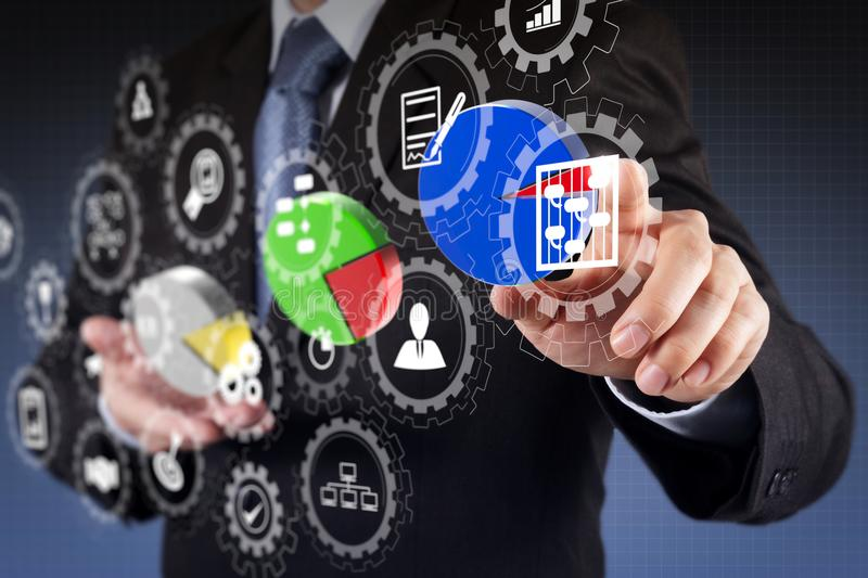 Businessman hand drawing a pie chart. AR virtual screen dashboard with project management with icons of scheduling, budgeting, communication.businessman hand royalty free stock photo