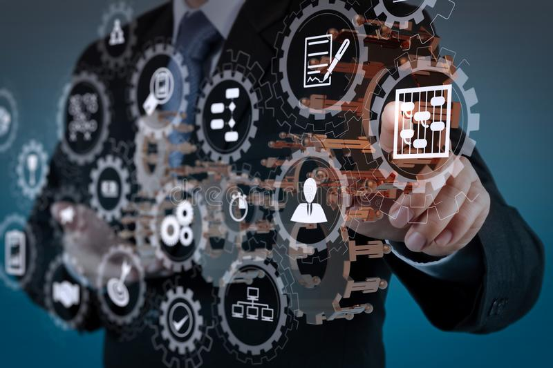 Businessman hand show gear to success. AR virtual screen dashboard with project management with icons of scheduling, budgeting, communication.businessman hand stock photo