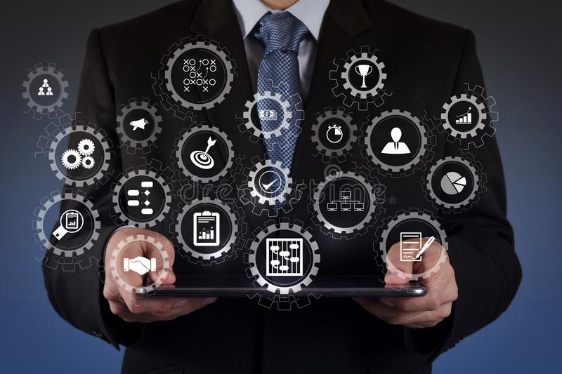 Businessman using tablet computer. AR virtual screen dashboard with project management with icons of scheduling, budgeting, communication.businessman hand using stock photos