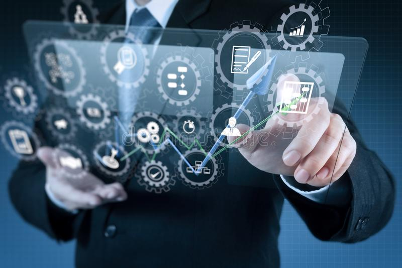 Businessman shows modern technology. AR virtual screen dashboard with project management with icons of scheduling, budgeting, communication.businessman shows royalty free stock images