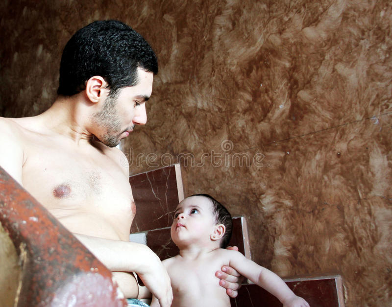 Arab baby girl with father stock photography