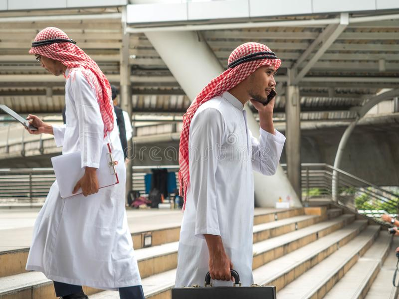 Arab business male useing on a mobile phone while traveling royalty free stock images