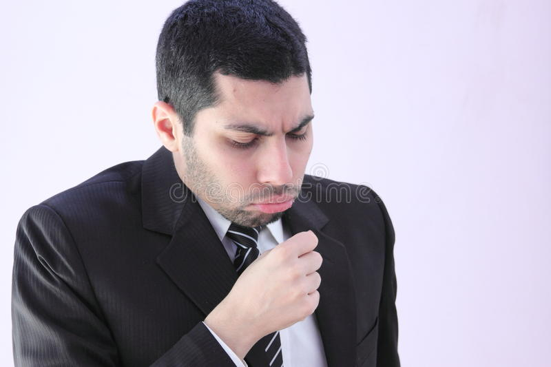 Arab business man has cough. Image of arab business man wearing black suit and has bad cough stock photos