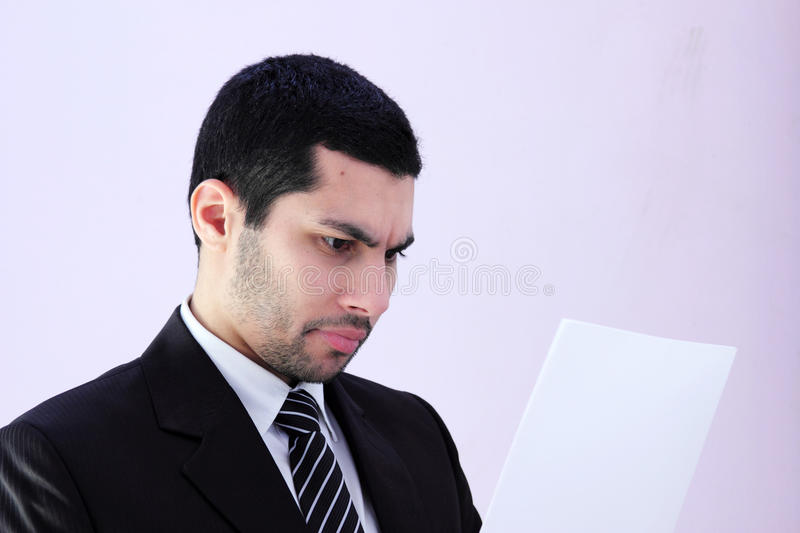 Arab business man. Image of arab business man wearing black suit and looking at work paper stock photos