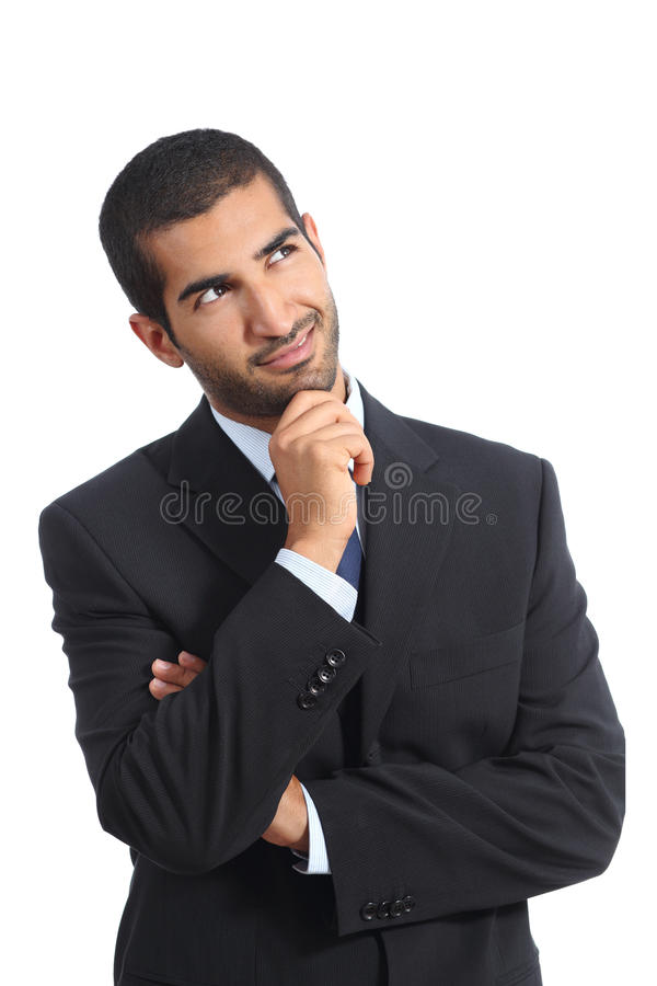 Arab business man thinking smiling looking sideways. Isolated on a white background stock image