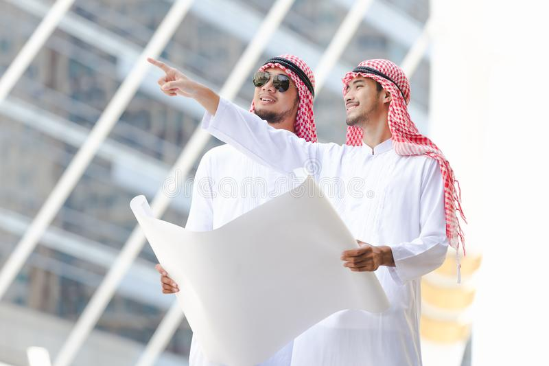 Arab business. Men looking working on plan peper in the city royalty free stock photo
